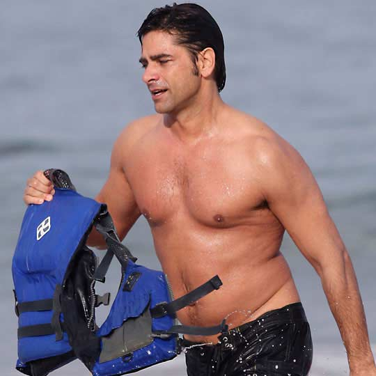 Shirtless John Stamos kayaking in Hawaii.  Splashnewsonline.com.